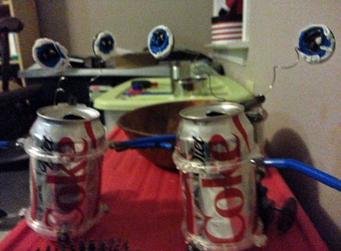 DIY robots made from a kids' science kit and soda cans