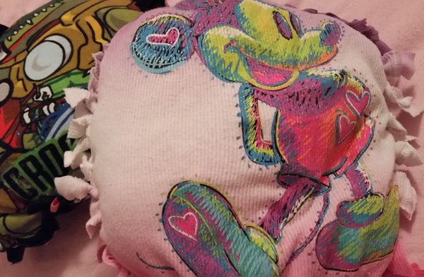 How to recycle a T-shirt into a pillow without sewing.